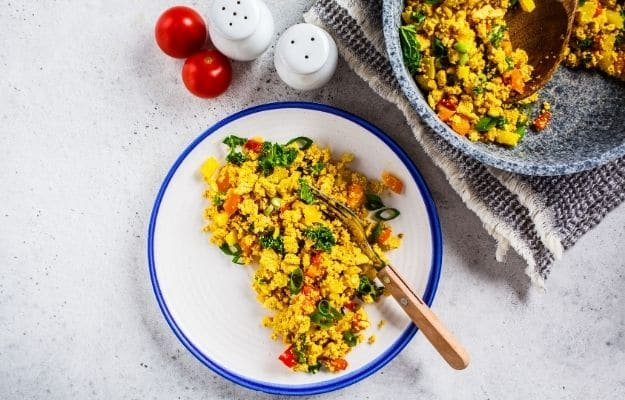 Tofu scramble with vegetables in white plate | Simple Tofu Scramble | 9 Easy Frozen Vegan Meals To Make Ahead