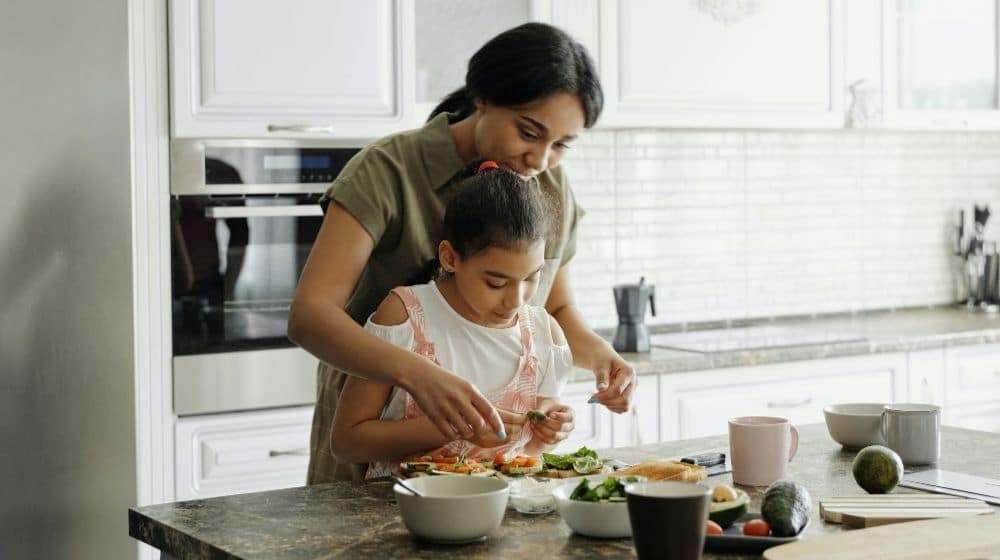 mom guiding her daughter how to cook vegan meals | Is a Vegan Diet Good for Children? | What Parents Should Know About Vegan Health