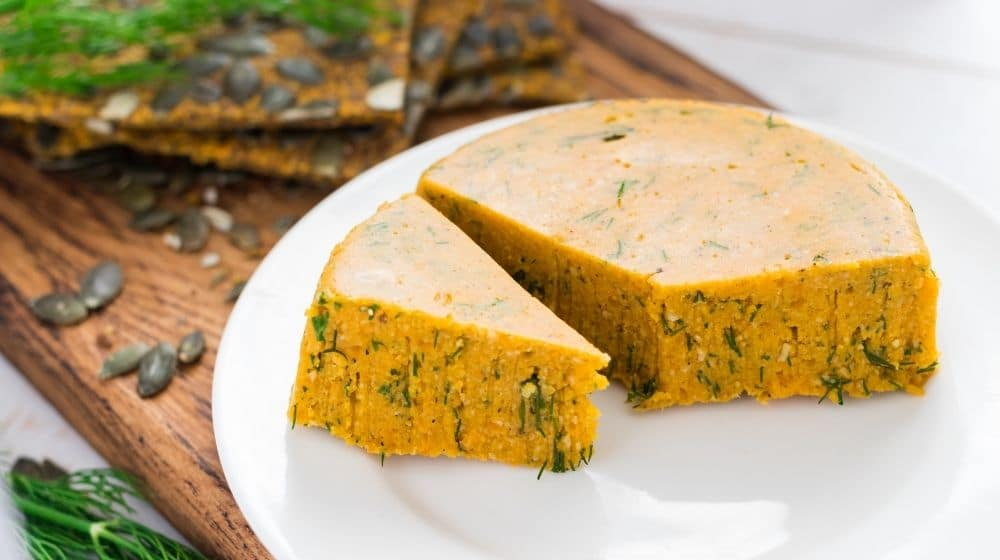 Raw vegan cheese with cashew, almond, carrot, pumpkin and herbs | Feature | The Many Vegan Cheese Choices