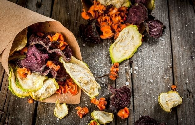 Dried vegetable chips from beets, carrots an zucchini-ca | 9 Best Vegan Snacks You Won't Feel Guilty About Eating | Baked Veggie Chips
