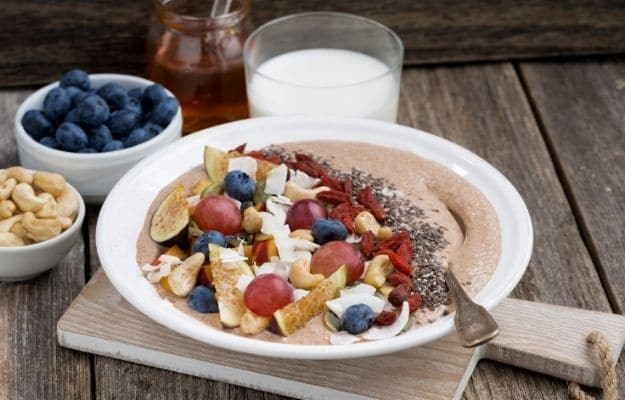 Oatmeal with fruit, nuts and chia for beakfast-ca | 9 Best Vegan Snacks You Won't Feel Guilty About Eating | Oatmeal With Fruit, Nuts (or Seeds)