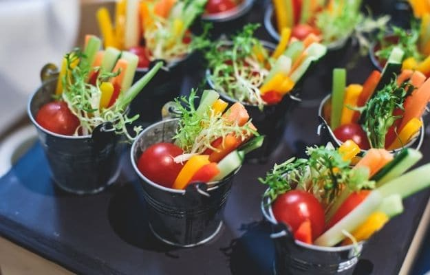 Beautifully decorated catering banquet table with variety of vegetables | 7 Decoration Is a Plus! |10 Tips For Choosing Vegan Recipes For The Holidays