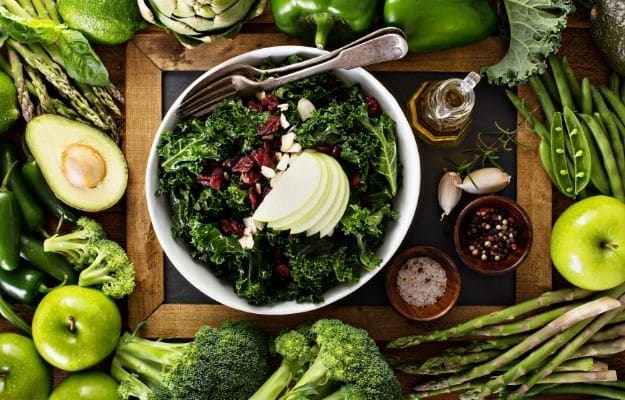 Health eating concept with kale salad and green vegetables-ca | Benefits Of A Keto Vegan Diet And What To Be Aware Of | Risks of a Keto Vegan Diet - Nutrient Deficiency & Solutions