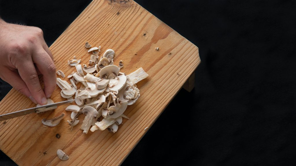 chopping shitake mushrooms